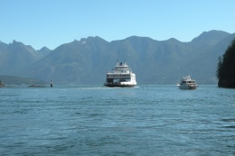 Bowen Island ferry saiilng into Snug Cove with a backdrop of North Shore mountains