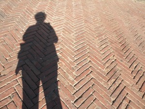 My shadow across the brickwork of the Campo