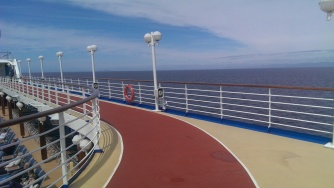 Walking track on the top deck of a Princess cruise ship during a sunny day at sea