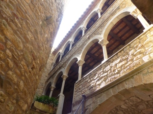 Looking up from the staircase leading up through the castle with the tower on the left