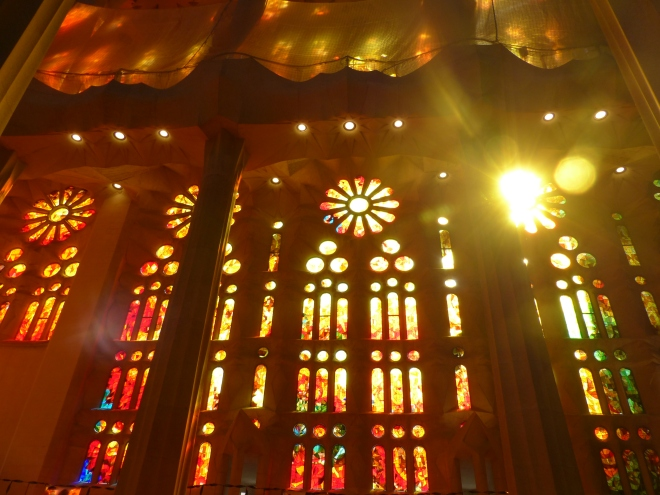 Inside the Sagrada Familia in Barcelona - the red and gold wall of windows