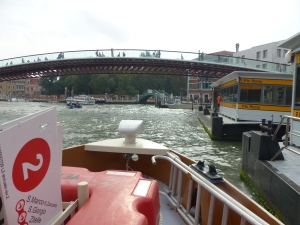 Sailing up the Grand Canal at the front of a vaporetta
