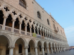 Doge's Palace gleaming pinkly in the early evening sun in Venice