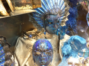 Bright blue carnival masks in a shop window in Venice