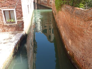 Reflections of buildings in a canal in Venice