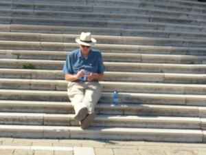 Man sitting on a long flight of stone steps