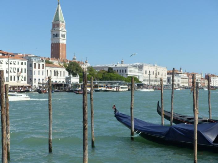 The Campanile tower in Venice and gondolas