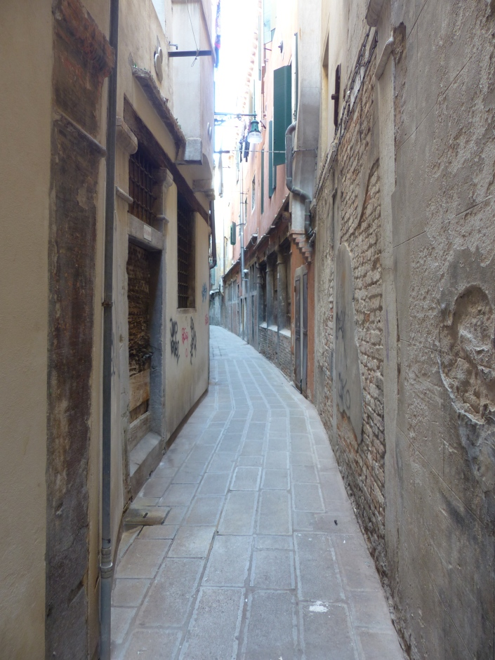 A narrow, brick cobbled street in Venice