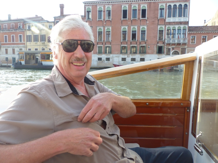 Man on a water taxi in Venice